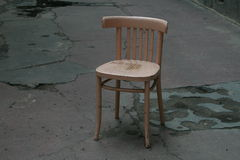 Empty chair symbolizing loneliness. Outdoor image Royalty Free Stock Photo