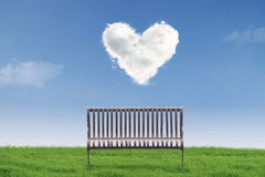 Empty chair under heart clouds Stock Images