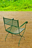 Empty chair on a wooden deck Stock Image