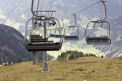 Empty chairlift in Austrian Alps. Royalty Free Stock Photo