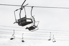 Empty chairlift with cloudy sky in the background Royalty Free Stock Photography