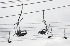 Empty chairlift with cloudy sky in the background Royalty Free Stock Images