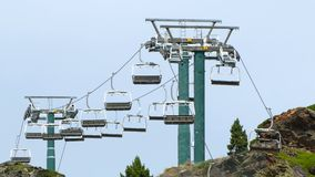 Empty chairlift. Empty chairlift moving slowly on the mountain peak stock video footage