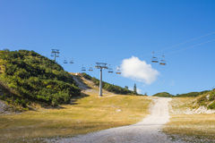 Empty chairlift over the ski resort Royalty Free Stock Image