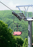 Empty chairlift Stock Images