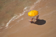 Empty chairs. View of bech chairs and a parasol Royalty Free Stock Image