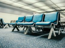 Empty chairs at the airport terminal lobby Royalty Free Stock Images