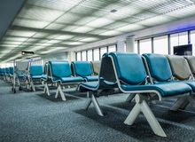 Empty chairs at the airport terminal lobby Stock Images