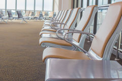 Empty chairs in airport waiting area Stock Photo