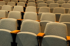 Empty chairs in auditorium. Close-up on empty chairs in auditorium Stock Photos