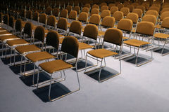 Empty chairs of an auditorium Stock Images