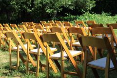 Empty chairs awaiting guests Stock Photos