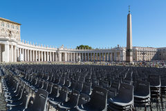 Empty chairs behind Cathedral of Saint Peter square Stock Image