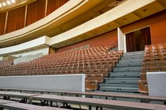 Empty chairs and benches in the auditorium. Concept: lack of interest, failure, boycott. Empty chairs and benches in the auditorium. Concept: lack of interest royalty free stock images