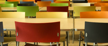 Empty chairs in a cafeteria. Panorama of rows of empty chairs in a cafeteria Royalty Free Stock Photo