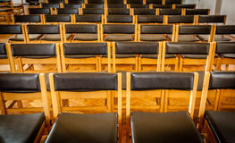 Empty chairs in the church stock image
