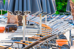 Empty chairs and closed umbrellas Stock Photo