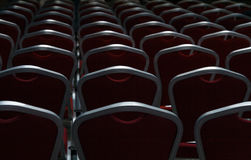 Empty chairs in a dark conference hall. Empty chairs in a dark big conference hall Royalty Free Stock Photos