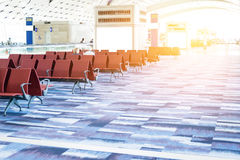 Empty chairs in the departure hall at airport . Stock Image