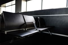 Empty chairs in the departure hall at airport. Travel and transportation concepts Stock Photography