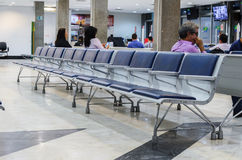 Empty chairs on departure lounge of Aeroporto Internacional de C Stock Photo