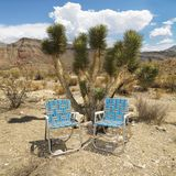 Empty chairs in desert. Royalty Free Stock Photography
