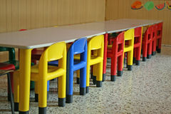 Empty chairs in a dining room of a kindergarten Stock Photos