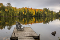 Empty Chairs on a Dock in Autumn - Ontario, Canada Stock Image