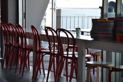 Empty chairs at empty tables. Empty Cafe waiting for the patrons to arrive Stock Photos