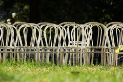 Empty chairs on field Stock Photo