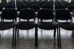 Empty chairs in the foyer of a hall stock photography