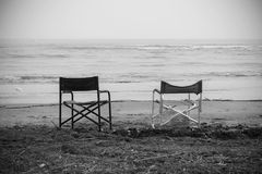 Empty chairs in front of sea Royalty Free Stock Photo