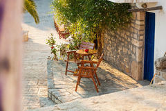 Empty chairs in the Greek village in summer royalty free stock photo