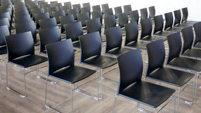 Empty chairs in a modern conference room Stock Image