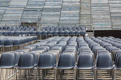 Empty chairs in an open air arena Stock Photos