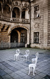 Empty chairs on the palace courtyard Stock Photo