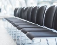 Empty chairs in a row. 10 empty chairs with nobody on them, in a waiting room Stock Photos