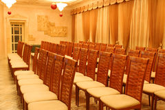 Empty chairs in rows at presentation in hotel stock image
