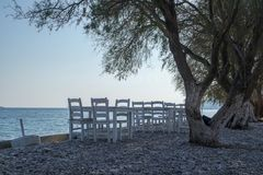 Empty chairs at the seaside royalty free stock image