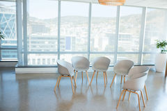 Empty chairs in the seating area. In office royalty free stock photography