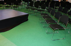 Empty chairs with a small stage for speaker Royalty Free Stock Images
