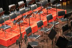 Empty chairs on a stage in concert theater.  Stock Photo