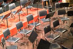 Empty chairs on a stage in concert theater.  Royalty Free Stock Photos