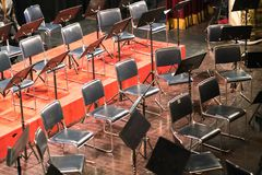 Empty chairs on a stage in concert theater.  Royalty Free Stock Images