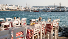Empty chairs and table at a Greek restaurant, Mykonos Island Gre Royalty Free Stock Image