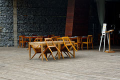 Empty chairs and tables at closed outdoor restaurant Stock Photo