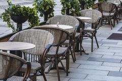 Cafe tables and chairs outdoor royalty free stock photo