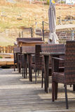Empty chairs and tables at a restaurant Stock Photos