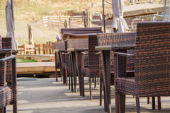 Empty chairs and tables at a restaurant Stock Image