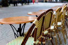 Empty chairs and tables at street café Stock Photo